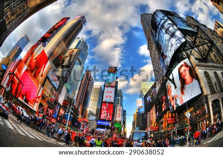 NEW YORK - Oct 8: Featured with Broadway Theaters and the famous animated LED signs through a fisheye lens and in HDR, October 8, 2014 in Manhattan, New York City - stock photo