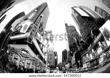 NEW YORK - Oct 9: Featured with Broadway Theaters, slogans and the famous animated LED signs through a fisheye lens in the evening, October 9, 2014 in Manhattan, New York City - Artistic BW image - stock photo
