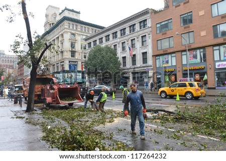 NEW YORK - OCT 30 : Hurricane Sandy leaves downed trees in Manhattan streets in October 30 2012 in New York. - stock photo