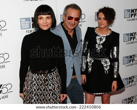 "NEW YORK-OCT 8: Juliette Binoche (L), director Olivier Assayas & Kristen Stewart (R) attend the ""Clouds of Sils Maria"" premiere at the New York Film Festival on October 8, 2014 in New York City.  - stock photo"