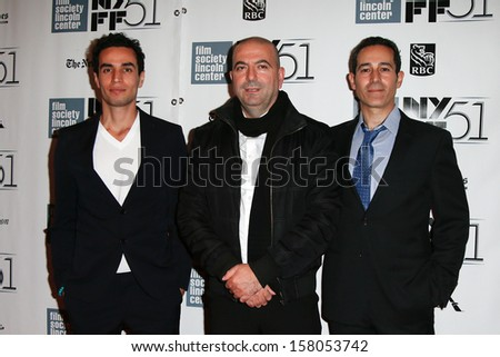 """NEW YORK-OCT 12: (l-r) Adam Bakri, Hany Abu-Assad and Waleed Zuaiter attend """"Her: A Spike Jones Love Story"""" premiere at the NY Film Festival at Alice Tully Hall on October 12, 2013 in New York City.  - stock photo"""