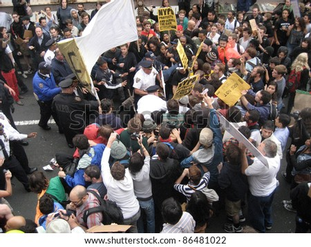 NEW YORK - OCT 1: Police confront a group of protesters on the roadway of the Brooklyn Bridge, October 1, 2011 in New York City. Hundreds of people were arrested at an Occupy Wall Street march. - stock photo