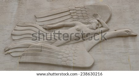 NEW YORK OCT 24: Rockefeller Center female figure riding on a swan. Her left arm is bent upright and her right arm is straight back. on Oct 24, 2013 in NY - stock photo