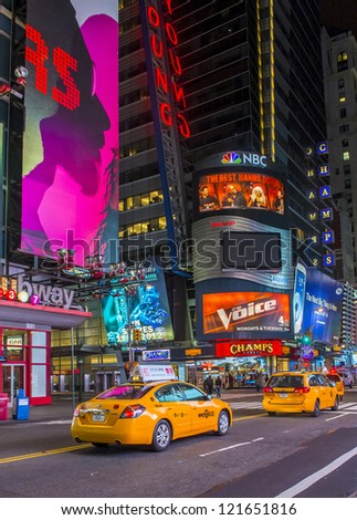 NEW YORK  - OCT 29 : The Times Square at night on October 29, 2012 in New York,Times Square is major commercial intersection in Manhattan and one of the most visited tourist attraction in the world. - stock photo