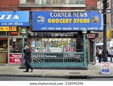 NEW YORK - OCTOBER 11: A corner store and a subway station on October 11 2013 in New York City. Many of the old subway entrances are now being modernized. - stock photo