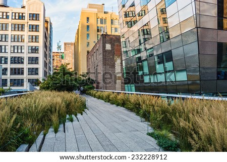 NEW YORK-OCTOBER 20:A mix of old and new architecture can be seen along the High Line Park on October 20, 2014 in Manhattan.  - stock photo