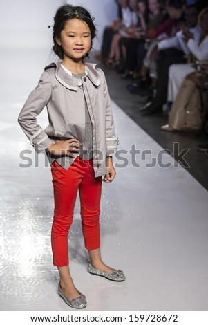 NEW YORK - OCTOBER 5: A model walks at Little Marc Jacobs preview during the Swarovski at petitePARADE NY Kids Fashion Week in Collaboration with Vogue Bambini on  OCTOBER 5, 2013 in New York - stock photo