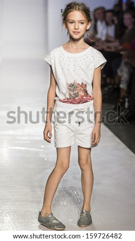 NEW YORK - OCTOBER 5: A model walks the runway at T-Shirt T-Shops preview during the Swarovski at petitePARADE NY Kids Fashion Week in Collaboration with Vogue Bambini on  OCTOBER 5, 2013 in New York - stock photo
