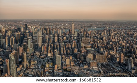NEW YORK - OCTOBER 29: aerial view of Manhattan on October 29, 2013 in New York. Manhattan is the geographically smallest yet most densely populated of all of New York City's five boroughs.