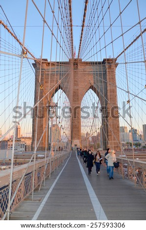 NEW YORK - OCTOBER 24:Brooklyn Bridge is one of the oldest suspension bridges in the USA. Completed in 1883 connects the New York boroughs of Manhattan and Brooklyn on October 24, 2013 in New York, - stock photo