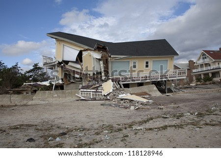 NEW YORK - October 31:Destroyed homes in  Far Rockaway after Hurricane Sandy October 29, 2012 in New York City, NY - stock photo
