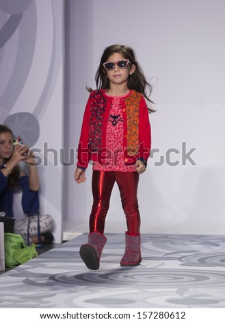NEW YORK - OCTOBER 5: Girl walks runway for truly scrumptious designed by Heidi Klum at Vogue Bambini petiteParade Kids Fashion Week at Industrial Superstudio on October 5, 2013 in New York City