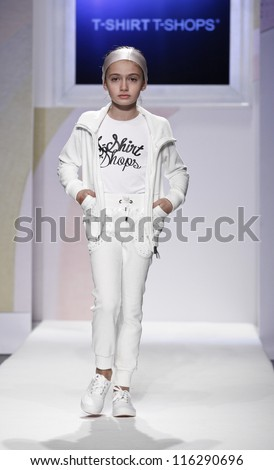 NEW YORK - OCTOBER 21: Girl walks runway petite Parade show by T-Shirts T-Shops during kids fashion week sponsored by Vogue Bambini & Swarovski Elements at Industria Supertudio on Oct 21, 2012 in NYC - stock photo