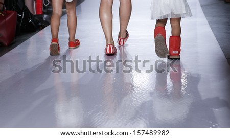 NEW YORK - OCTOBER 5: Model and kids walk runway for Ugg Australia ...