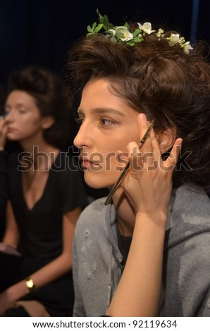 NEW YORK - OCTOBER 15: Model getting ready backstage at the Claire Pettibone Bridal Collection for Spring/ Summer 2012 during NY Bridal Fashion Week on October 15, 2011 in New York, USA