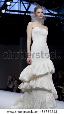 NEW YORK - OCTOBER 16: Model walks runway for Badgley Mischka bridal collection by Mark Badgley & James Mischka at New York International Bridal Week at 94 Pier on October 16, 2011 in New York City, NY - stock photo
