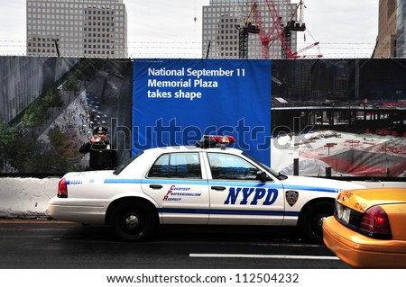 NEW YORK - OCTOBER 09: NYPD policeman guards the One World Trade Center site on October 09 2009 in Manhattan New Center, USA. - stock photo