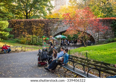 NEW YORK-OCTOBER 29 -  People relaxing in Central Park on a beautiful Autumn day in New York City. - stock photo