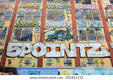 "NEW YORK - OCTOBER 15: 5 Pointz on October 15, 2013 in New York. 5 Pointz was an outdoor art exhibit space in Long Island City, considered to be the world's premiere ""graffiti mecca."" - stock photo"