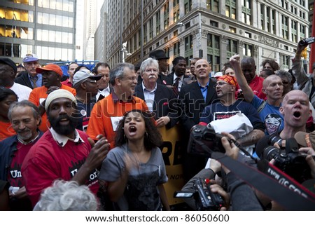 NEW YORK - OCTOBER 05: President of TWU Local 100 John Samuelsen speaks at the rally with 'Occupy Wall Street' in Downtown Manhattan on October 05, 2011 in New York. - stock photo