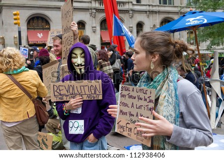NEW YORK - OCTOBER 4: Protestors in Zuccotti Park during the Occupy Wall Street movement on October 4, 2011 in New York City, NY.  which began in Zuccotti Park on September 17, 2011. - stock photo