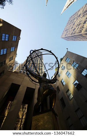 NEW YORK , OCTOBER 4: statue of atlas in front of the Rockefeller center in New York on Oct 4 2010. The sculpture depicts the Ancient Greek Titan Atlas holding the heavens. - stock photo