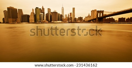 New York - Panoramic view of Manhattan Skyline and Brooklyn Bridge - stock photo