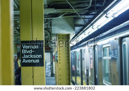 New York - Queens subway station with train stopping. - stock photo