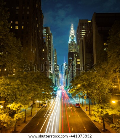 New York's famous 42nd Street at night long exposure with Times Square in the distance