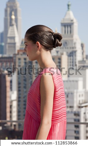 NEW YORK - SEPT 10: A model poses at the ANN YEE Spring/Summer 2013 collection presentation at The Standard East Village Penthouse during Mercedes-Benz Fashion Week in New York on September 10, 2012. - stock photo