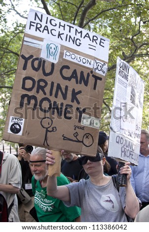 NEW YORK - SEPT 17: A protester opposing fracking holds a sign that reads 'You Cant Drink Money'  on the 1yr anniversary of the Occupy Wall St protests on September 17, 2012 in New York City, NY. - stock photo