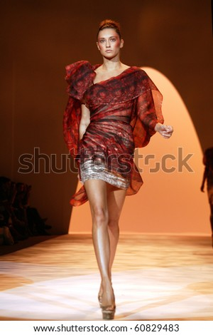 NEW YORK - SEPTEMBER 9: A model is walking the runway at the Christian Siriano collection presentation for Spring/Summer 2011 during Mercedes-Benz Fashion Week on September 9, 2011 in New York. - stock photo