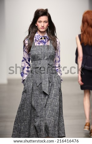 NEW YORK - SEPTEMBER 08: A model walks the runway at Karen Walker Spring-Summer 2015 fashion show during New York Fashion Week on September 08, 2014 in NYC.  - stock photo