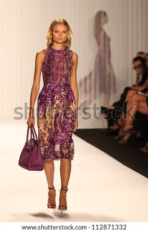 NEW YORK - SEPTEMBER 12:A model walks the runway at the J.MENDEL Spring/Summer 2013 collection Mercedes-Benz Fashion Week in New York on September 12,2012