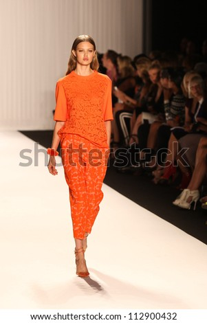 NEW YORK - SEPTEMBER 12:A model walks the runway at the J.MENDEL Spring/Summer 2013 collection Mercedes-Benz Fashion Week in New York on September 12,2012 - stock photo
