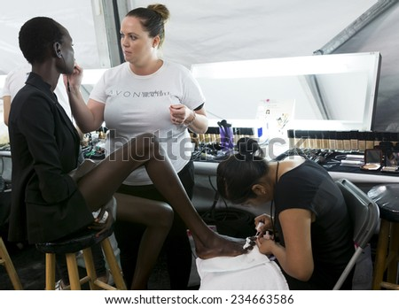 NEW YORK - SEPTEMBER 08, 2014: Ajak Deng prepares backstage at the Dennis Basso Spring 2015 fashion show during Mercedes-Benz Fashion Week at The Theatre at Lincoln Center