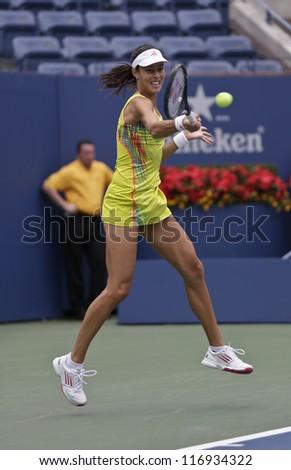 NEW YORK - SEPTEMBER 3: Ana Ivanovic of Serbia returns ball during 4th round match against Tsvetana Pironkova of Bulgaria at US Open tennis tournament on September 3, 2012 in Flashing Meadows New York - stock photo