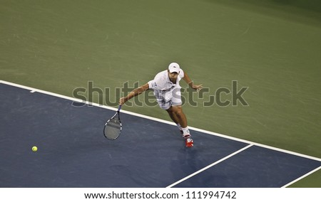 NEW YORK - SEPTEMBER 4: Andy Roddick of USA returns ball during Quarterfinal match against Juan Martin Del Potro of Argentina at US Open tennis tournament on Sep 4, 2012 in Flushing Meadows New York - stock photo