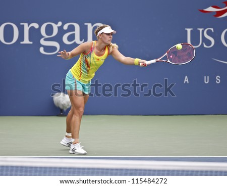 NEW YORK - SEPTEMBER 03: Angelique Kerber of Germany returns ball during 4th round match against Sara Errani of Italy at US Open tennis tournament on September 3, 2012 in Flashing Meadows New York