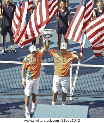 NEW YORK - SEPTEMBER 07: Bob & Mike Bryan of USA with winner trophy for men double at US Open tennis tournament on September 7, 2012 in New York City