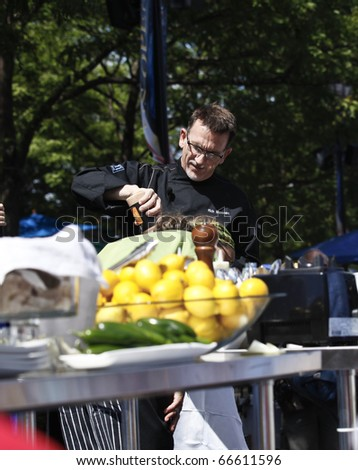 NEW YORK - SEPTEMBER 04: Chef Rick Moonen from the Champions Round of Top Chef Masters shows cooking techniques at US Open Tennis Championship on September 04, 2010 in New York, City. - stock photo
