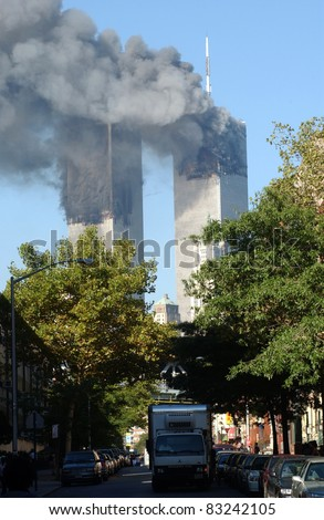 NEW YORK - SEPTEMBER 11  - Clouds of smoke rise  from fires at the World Trade Center Towers as a result of terrorist attack on September 11, 2001. Photographed 9:54 am in Lower Manhattan. - stock photo