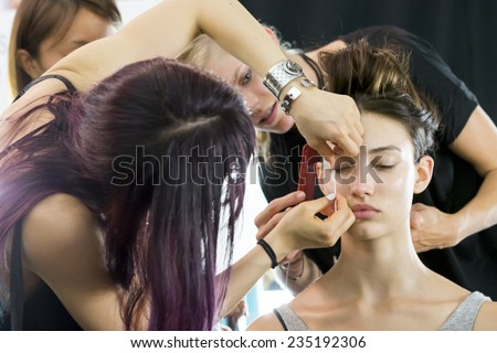 New York - September 05, 2014: Dana Taylor prepares backstage at the Monique Lhuillier Spring 2015 fashion show during Mercedes-Benz Fashion Week at The Theatre at Lincoln Center