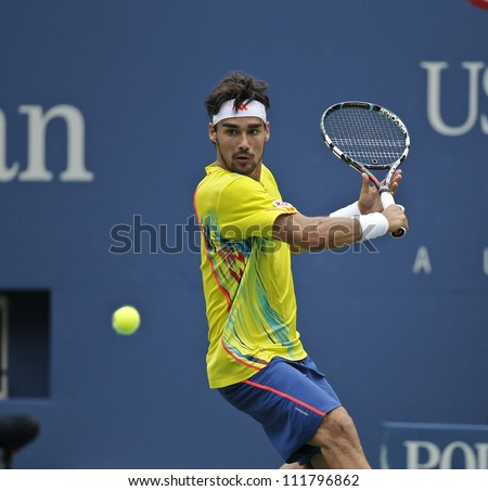NEW YORK - SEPTEMBER 2: Fabio Fognini of Italy returns ball during 4th round match against Andy Roddick of USA at US Open tennis tournament on September 2, 2012 in Flashing Meadows New York - stock photo