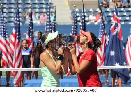 NEW YORK - SEPTEMBER 13, 2015: Five times Grand Slam champion Martina Hingis (L) and Sania Mirza (R) during women's doubles trophy presentation at US Open 2015