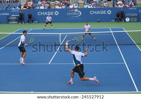 NEW YORK -SEPTEMBER 1, 2014: Grand Slam champions Mike and Bob Bryan (at the front) during US Open 2014 round 3 doubles match at Billie Jean King National Tennis Center in New York - stock photo