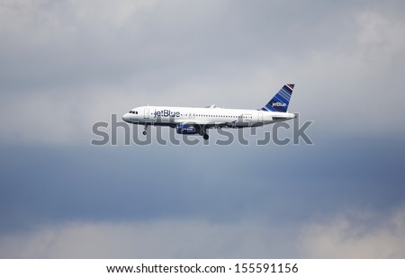 NEW YORK - SEPTEMBER 8 JetBlue  Airbus A320 in New York sky before landing in La Guardia Airport on September 8, 2013  JetBlue serves 79 destinations in 24 states, and 12 countries  - stock photo