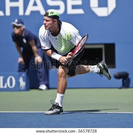 NEW York - September 5: Lleyton Hewitt of Australia returns a shot during 3rd round match against Roger Federer of Switzaland at US Open on September 5 2009 in New York - stock photo