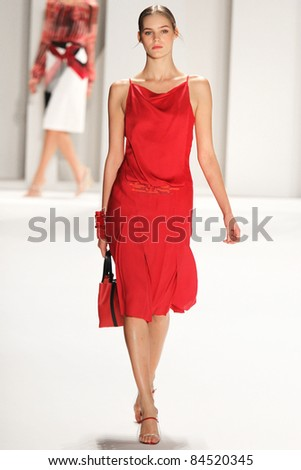 NEW YORK - SEPTEMBER 12: Model walks the runway at the Carolina Herrera S/S 2012 collection presentation during Mercedes-Benz Fashion Week on September 12, 2011 in New York. - stock photo