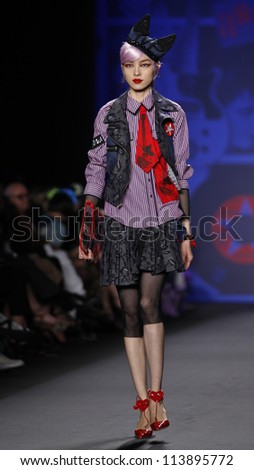 NEW YORK - SEPTEMBER 12: Model walks the runway for Anna Sui Collection during Spring/Summer 2013 at Mercedes-Benz Fashion Week on September 12, 2012 in New York - stock photo